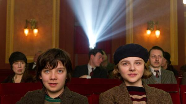 Orphan Hugo Cabret (Asa Butterfield and his vivacious new friend Isabelle (Chloe Grace Moretz) marvel at the magic of the motion picture in <em>Hugo.</em>