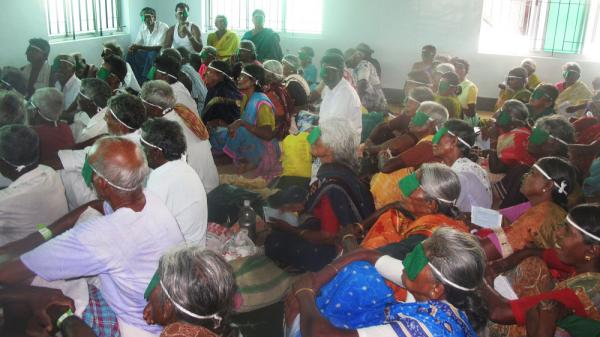 Patients who have received free surgery at one of the Aravind hospitals get instructions before going home.