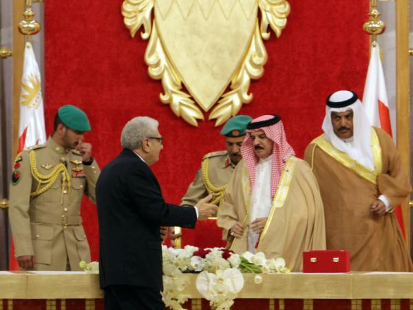 Cherif Bassiouni, second from left, head of the commission charged with investigating Bahrain's uprising which took place earlier this year, presents a report to Bahrain's King Hamad bin Isa Al Khalifa, second from right, in Sakhir Palace in Sakhir, Bahrain on Wednesday.
