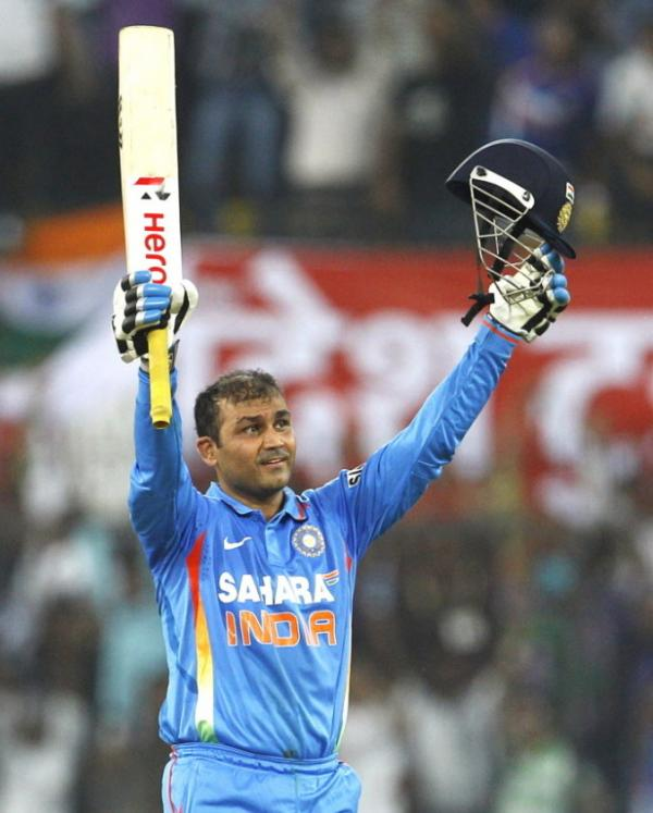 "India's captain Virender Sehwag celebrates his ""double century."""