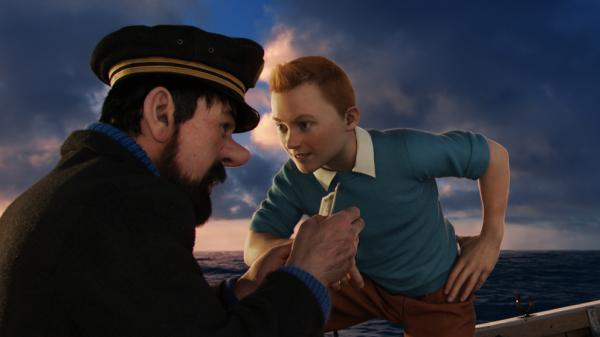 Captain Haddock (Andy Serkis, left) and Tintin (Jamie Bell) chase fortune and treasure in <em>The Adventures of Tintin.</em>