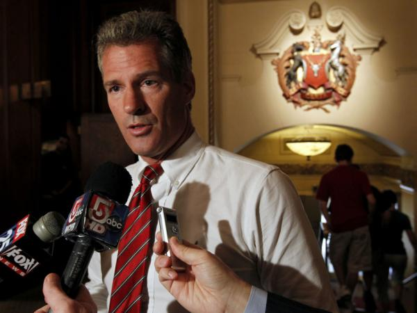 Sen. Scott Brown addresses reporters at a Boston hotel in August. Brown won the seat in a 2010 special election in large part by contrasting himself with the Kennedy dynasty.