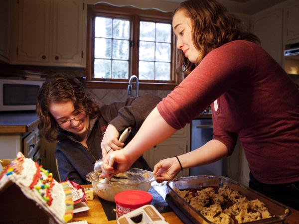 Laurel and her twin sister Heather bake together at their home in North Attleboro, Mass., on Friday, December 23, 2011.