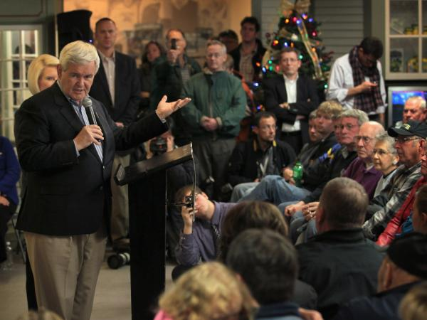 Former Speaker of the House Newt Gingrich complained about negative ads against him during a campaign stop at the National Toy Farm Museum on Dec. 27 in Dyersville, Iowa.