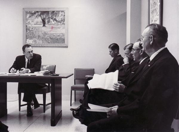Wallace Kuralt (left), the head of the Mecklenburg County welfare program in North Carolina, speaks to the Welfare Board in 1962. The county sterilized 485 people — about three times more than any other in the state. More than 7,000 people were sterilized in North Carolina.
