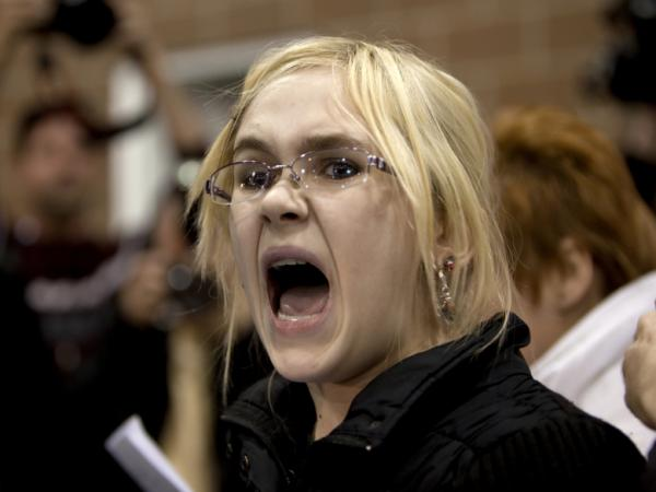 Occupy protester Heaven Ryan, 16, disrupted Ron Paul as he spoke at the Knapp Learning Center in Des Moines, Iowa, Wednesday.