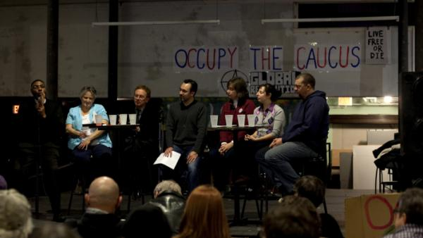 Community activists speak Thursday at an Occupy movement event in Des Moines, Iowa.