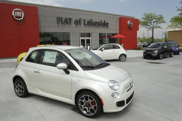 In its 2011 re-entry into the U.S. market, Italian automaker Fiat opened 130 dealerships — or studios, as the company calls them — that sold only the Fiat 500, displayed here outside the Fiat of Lakeside dealership in Macomb, Mich.