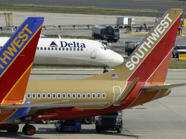 Two Southwest Airlines jets are seen in front of a taxiing Delta jet at Philadelphia International Airport in 2004.