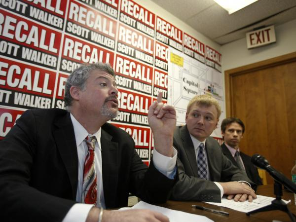Jeremy Levinson, (l) a lawyer to the recall committees, talks about the petitions as Mike Tate (c)  Wisconsin Democratic Party chair listens, Tuesday, Jan. 17, 2012.
