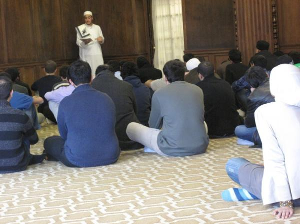 Muslim students at the University of Michigan listen to a sermon delivered by sophomore Mohamad Omar Hadied during Friday prayer.