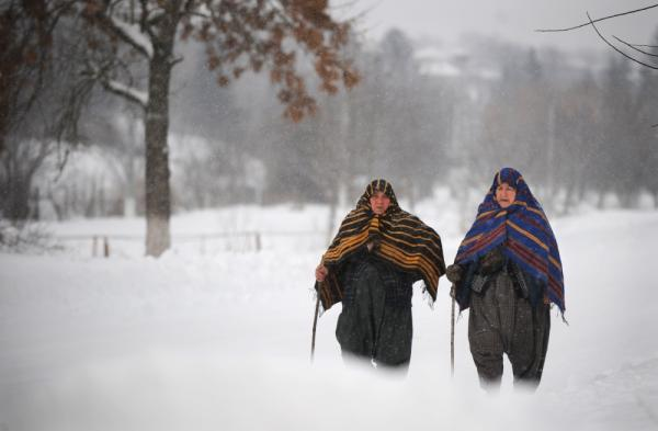 Bulgarian women walk during a snowfall in the village of Rakovski, northeast from capital Sofia.