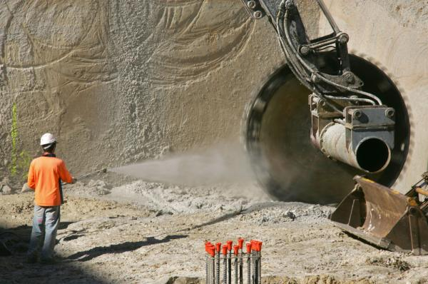 A worker sprays water onto a large circular saw as the machine cuts sandstone in Sydney, Australia, in 2005. Applying water can help reduce the amount of dust that makes it into the air.