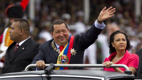 President Hugo Chavez waves during a military parade in Caracas, Venezuela, to commemorate the 20th anniversary of a failed coup attempt he led. After battling cancer last year, Chavez has returned to his high-profile, fiery ways.