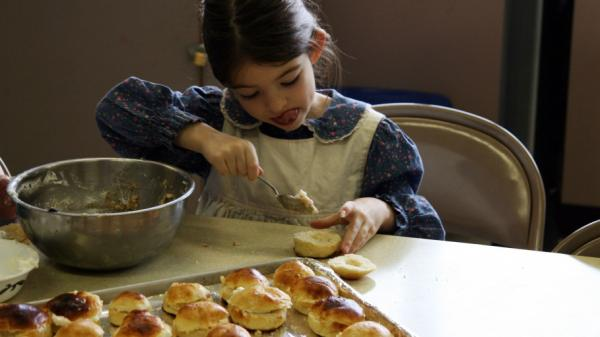 "Filling semlor with sweet almond paste requires great concentration from Astrid Foster, age 7. Get the recipe for <a href=""http://www.npr.org/2012/02/16/146985466/swedish-fat-tuesday-delicacy-kept-alive-in-portland#147040528"">semlor</a>."