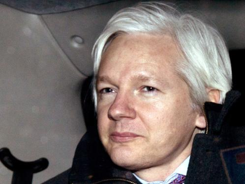 WikiLeaks founder Julian Assange is driven away in a taxi after leaving his hearing at the Supreme Court in London, Thursday, Feb. 2, 2012.
