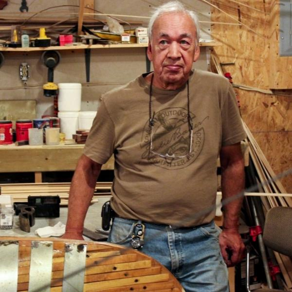 Canoe builder Joe Goudie in his workshop in Happy Valley-Goose Bay, Canada. Goudie, 72, is completing his last canoe for sale.