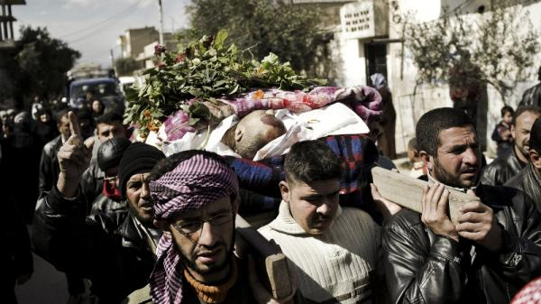 Syrian mourners in Qusayr, a few miles outside Homs, carry the body of a man killed by shrapnel, during his funeral on Tuesday. After a month-long assault by the Syrian army, rebels were forced to retreat from Homs on Thursday.