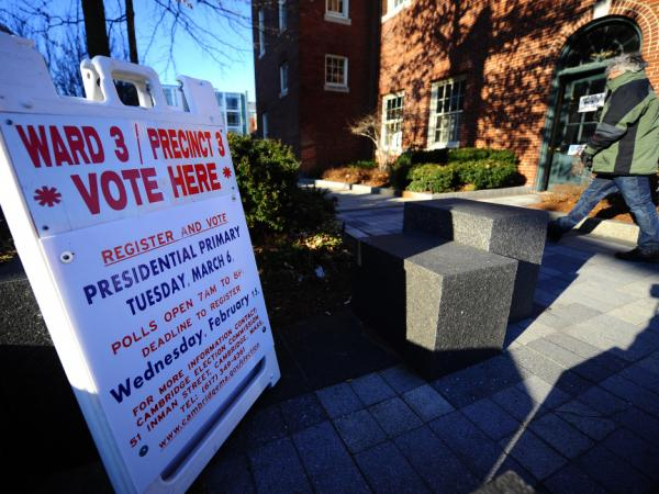 Ten states hold GOP nominating contests on March 6. Here a voter heads to a polling station Tuesday morning in Cambridge, Mass., where former Gov. Mitt Romney is expected to win his home state.