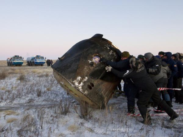 Russia's space agency ground personnel check a Soyuz TMA-02 capsule after its landing near the town of Arkalyk in northern Kazakhstan, on Nov. 22, 2011. The next Soyuz launch, to send a relief crew to the International Space Station, is scheduled for May 15.