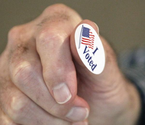 """In Madison, Miss., earlier today, precinct worker Bob Shirley was handing out """"I Voted"""" stickers."""