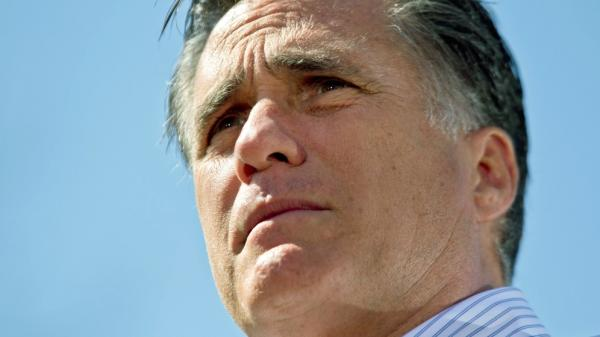 "By talking about ""restoring"" the past, Mitt Romney hopes his campaign will have broad appeal. Here he addresses supporters during a campaign stop at Kirkwood Park on March 13 in Kirkwood, Missouri."