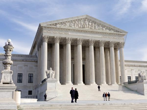 Justices heard arguments Monday in a case that attempts to reconcile modern in vitro fertilization technology with a 1939 law.