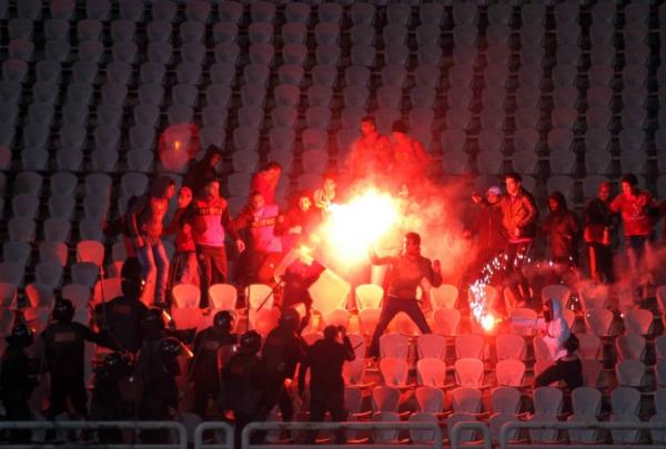 Egyptian soccer fans clash with riot police following a match between the hometown Al-Masry team and Cairo's Al-Ahly at the soccer stadium in Port Said, Egypt, on Feb. 1.