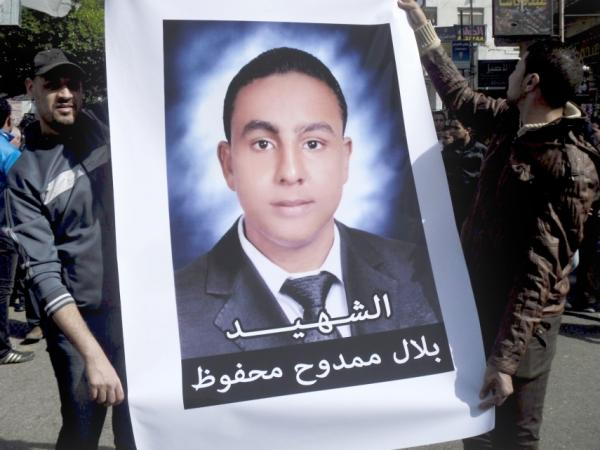 On March 24, Egyptians hold a poster with a photo of Belal Mamdouh, a teenager who was killed during clashes between soccer fans and Egyptian soldiers following the ban of the Port Said soccer team.