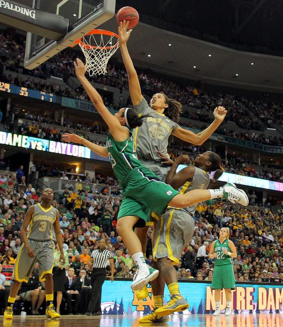 Brittney Griner (#42) of the Baylor Lady Bears blocks a shot attempt by Kayla McBride (#23) of the Notre Dame Fighting Irish during Tuesday night's NCAA Division I women's basketball championship game in Denver.