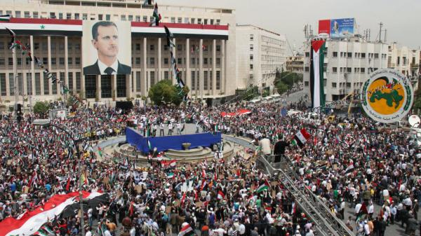 Syrian President Bashar Assad was supposed to pull the military out of cities by Tuesday, but more attacks were reported. Some Syrians rallied in support of Assad and his Baath Party in the capital, Damascus, on Saturday.