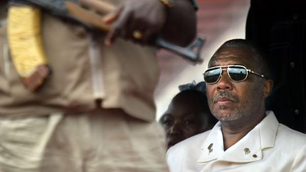 Liberian President Charles Taylor, shown here in the capital Monrovia in 2003, is charged with 11 counts of war crimes and crimes against humanity — including murder, rape, sexual slavery and the use of child soldiers — in neighboring Sierra Leone. A verdict is expected Thursday.