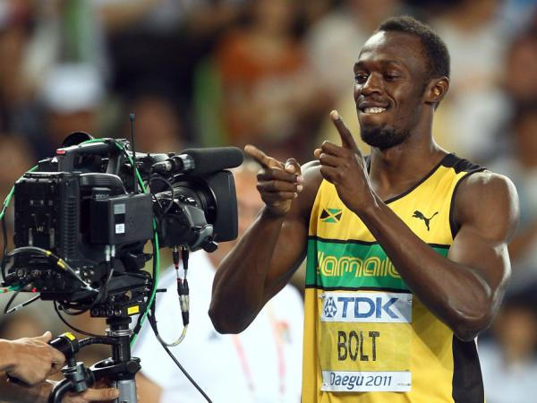 Many track fans watched online four years ago, as sprinter Usain Bolt set a world record at the Beijing Olympics. This year, NBC will stream video of all 302 events online. And Bolt, seen here showing his appreciation for video in 2010, will try to repeat his feat.
