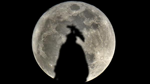 "The statue of Freedom, atop of the U.S. Capitol Building, is pictured against a ""supermoon"" on March 19, 2011."