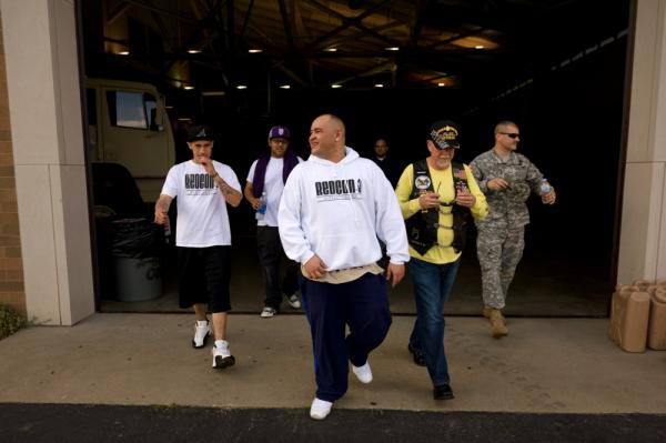 Barillaro (center) leaves the armory after a sound check for his evening hip-hop performance. The 35-year-old comes from a military family; he says he has wanted to be a soldier since he was 12 years old. While in Iraq, he led convoys for the Army.