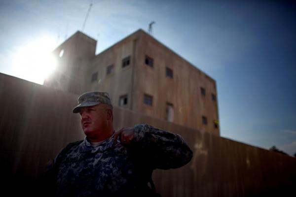 Col. Michael Kasales stands outside a mock Afghan village at Fort Polk, La., where U.S. Army soldiers are learning how to train Afghan security forces.