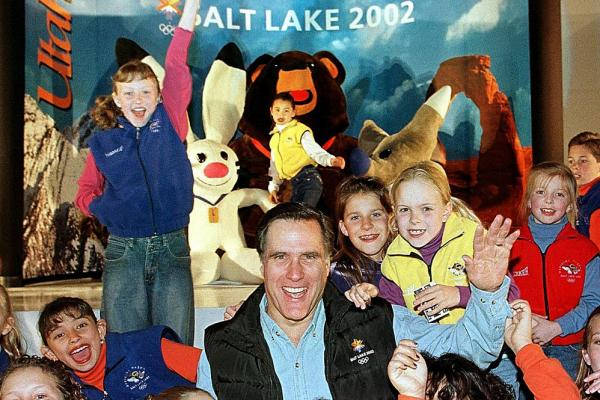 Serving as Salt Lake Organizing Committee president and CEO, Romney celebrates with children from the Children's Dance Theater in 1999.