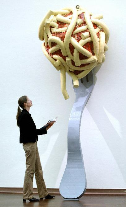 """Oldenburg's <i>Leaning Fork with Meatball and Spaghetti II, 1994</i> was part of the 2004 exhibition """"Das Grosse Fressen,"""" or """"Food Galore,"""" in Bielefeld, Germany."""