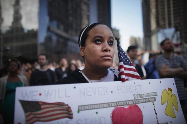 Nia Evans, who lost a friend at the World Trade Center, observes a moment of silence in New York City.