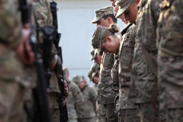 U.S. soldiers pray at an anniversary ceremony at Bagram Air Field in Afghanistan.