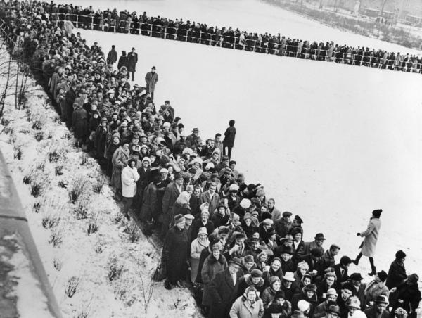 Thousands of people line up in East Berlin to apply for passage into the West on Dec. 19, 1963.
