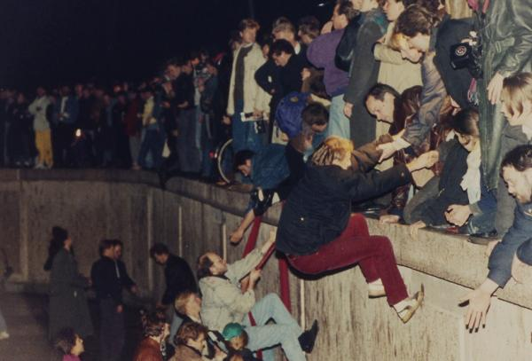 West Berliners help East Berliners over the wall on Nov. 10, 1989.