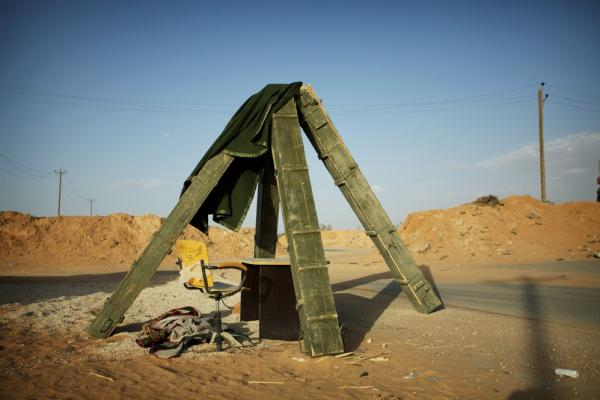 Ammunition crates are set up as a makeshift shelter at a checkpoint near Kikla in the Nafusa Mountains.