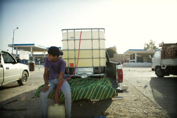 Gas stations are no longer open in western Libya. All the fuel is being brought in from Tunisia. Gas is sold from tanks in the beds of pickup trucks.