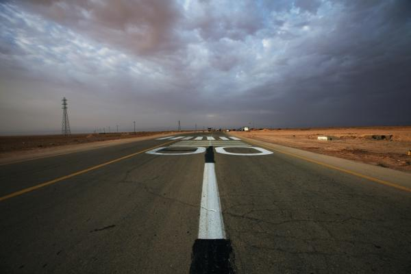 The makeshift runway in Rhybat serves planes flying between the rebel stronghold of Benghazi in the east and the Nafusa Mountains in the west.