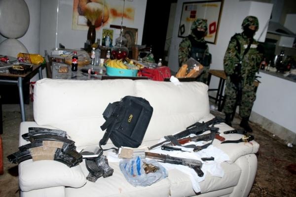 <b>Killed Dec. 16, 2009:</b> Arturo Beltran Leyva, then-leader of the Beltran Leyva gang, is killed in a shootout with some 200 Mexican marines in the city of Cuernavaca. Mexican troops stand guard the following day inside the apartment where Beltran Leyva and three members of his cartel were slain.