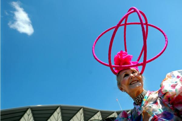 Florence Claridge poses with her hat, a creation by milliner David Shilling, during Ladies Day in 2010.