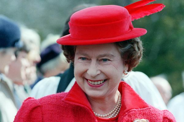 Considered a substitute for the royal crown, hats allow Queen Elizabeth II to be easily identified. As monarch over the past 50 years, the queen has worn about 5,000 hats. Here, she smiles as she leaves the Royal Chapel in Windsor Great Park, England, after attending morning prayers on April 20, 1986.