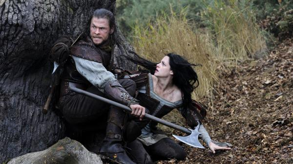 The huntsman (Chris Hemsworth) is promised that his beloved wife will be brought back from the dead if he captures Snow White (Kristen Stewart.)