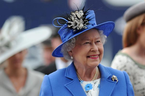 Britain's Queen Elizabeth II arrives on Derby Day in Surrey on Saturday, the first official day of her Diamond Jubilee celebrations.